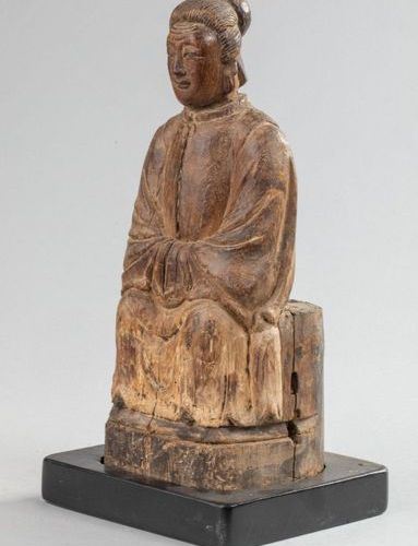 Pretty PORTRAIT OF AN ANCIENT SEATED WITH A MONASTIC DRESS covered with a button…