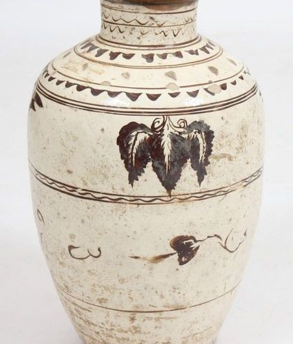 LARGE CIZHU JAR  In glazed terracotta with vine leaf decoration and geometric mo…