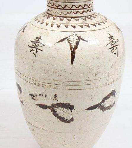 LARGE CIZHU JAR  In glazed terracotta with leaf decoration, writing and geometri…