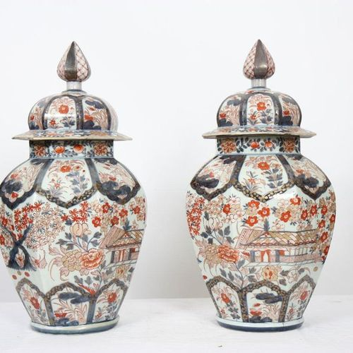 IMPORTANT PAIR OF COVERED IMARI PORCELAIN VASES  Octagonal in shape with polychr…