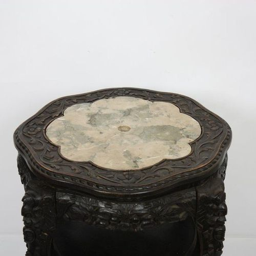POLYLOBE GUERIDON WOOD CARVED ASIAN CARVING  Made of carved precious wood, with …