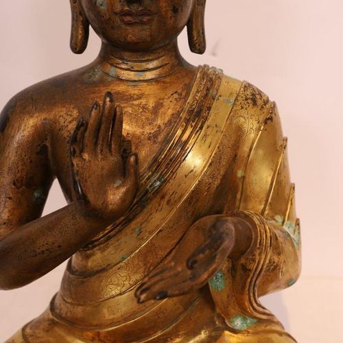 BUDDHA SEATED in gilt bronze  17th century style  H: 45 cm  Use and maintenance …