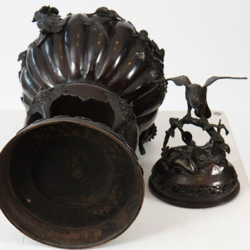 BURNER BRONZE COVERED PERFUME  on a tripod base resting on a circular base with …