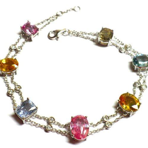 Delightful white gold bracelet set with 7 multicoloured Ceylon sapphires in NATU…