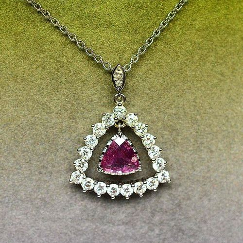 White gold pendant centered with a rare NATURAL Pink Sapphire troïdia cut of bea…