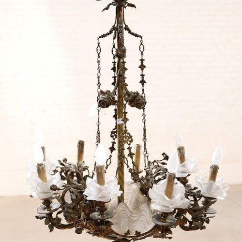TWELVE LIGHT SHELL CHANDELIER  In gilt bronze with four pairs of arms and four l…