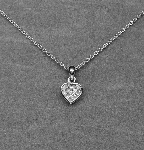 A very surprising heart pendant set with 8 princess diamonds in a mysterious G V…