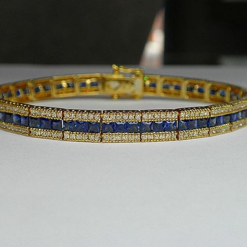 Yellow gold line bracelet set with beautifully coloured calibrated sapphires for…