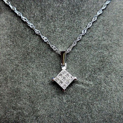 "A pendant in the shape of a ""diamond"" set with 9 diameters (G VS) in invisible s…"