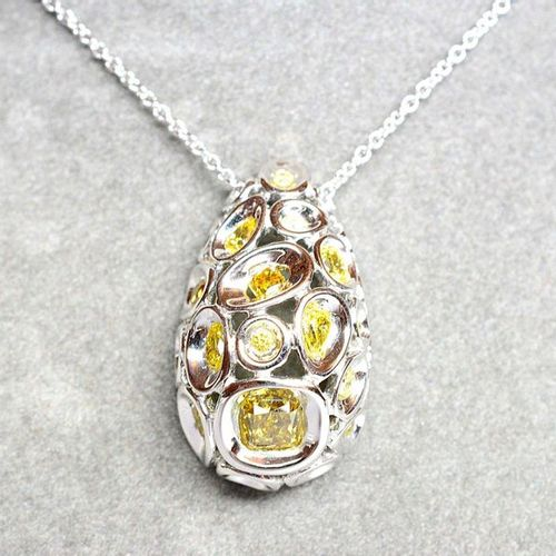 Pendant in white gold set with 20 NATURAL yellow and orange coloured diamonds, o…