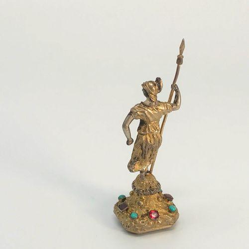 """Cachet """"Renommée"""" En bronze argenté et doré. La base sertie d'améthystes et turq…"""