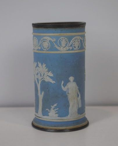 A small wedgwood pot with its silver metal frame