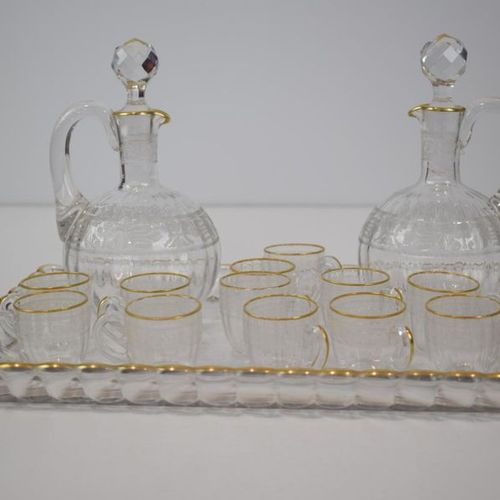 BACCARAT A small crystal liqueur set comprising a tray, two carafes and twelve c…