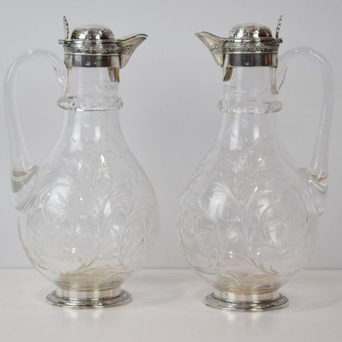 A pair of crystal ewers set in silver Minerva