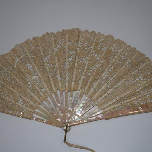 A fan made of tortoiseshell and black lace and a fan made of mother of pearl and…