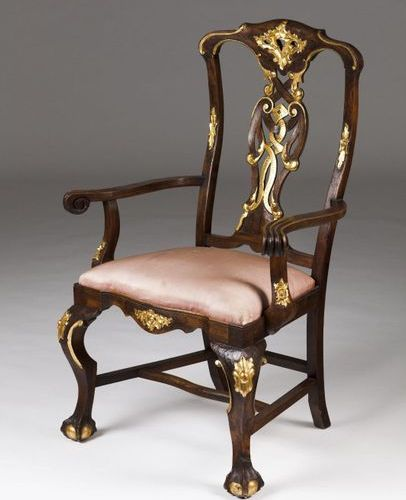 A Rococo style armchair Walnut  Part carved and gilt decoration  Claw and ball f…