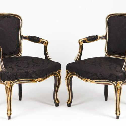 A pair of Louis XV style fauteuils Painted and gilt wood  Damask upholstered sea…