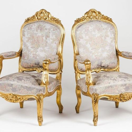 A pair of Regence style armchairs Carved and gilt wood  Damask upholstered seats…