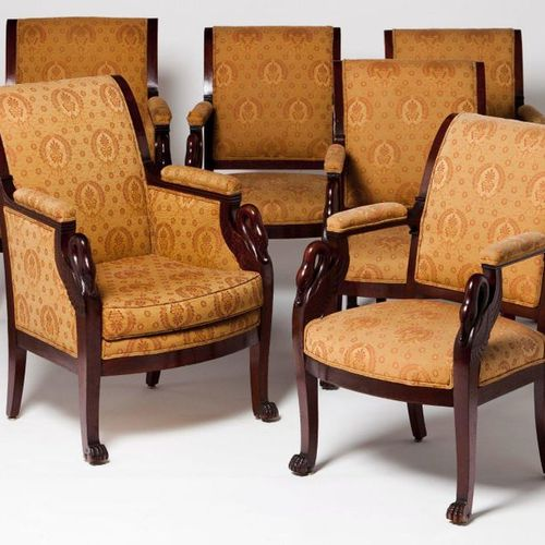 A set of four Empire style fauteuils Mahogany  Carved decoration  Textile uphols…