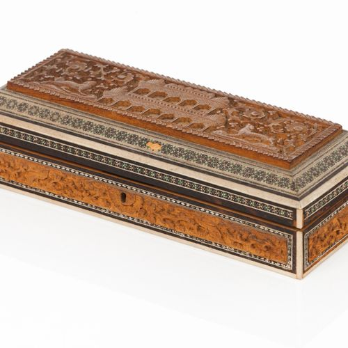 An Indian box Sandalwood  Carved decoration of foliage motifs and buildings to c…