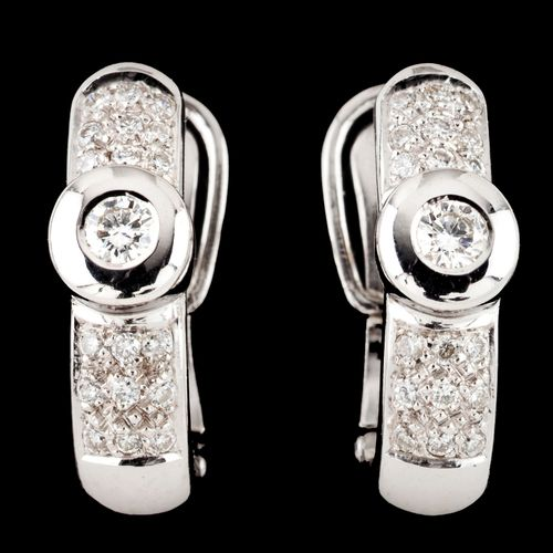 A pair of earrings Gold  Set with two brilliant cut diamonds totalling (ca. 0.20…