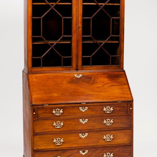 A George III bureau bookcase Mahogany  Four drawer bureau of inner small drawers…