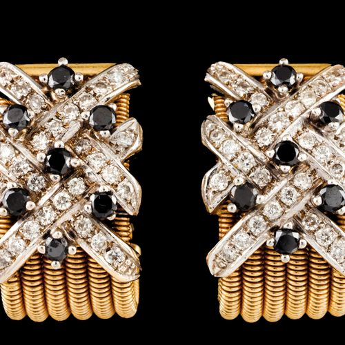 A pair of earrings Bicoloured gold  Fluted links set with crossed applied elemen…