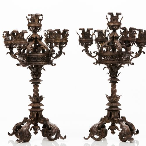 A pair of neo gothic candelabra Patinated metal  Five branches  Foliage and twis…