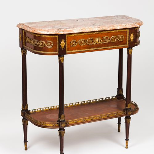 A Louis XVI style console table Mahogany  Gilt bronze mounts  One drawer  Lioz m…