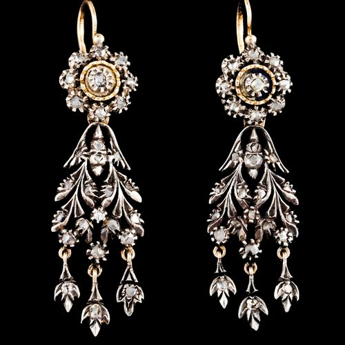 A pair of drop earrings Silver and gold  Rose shaped top of floral drop and arti…