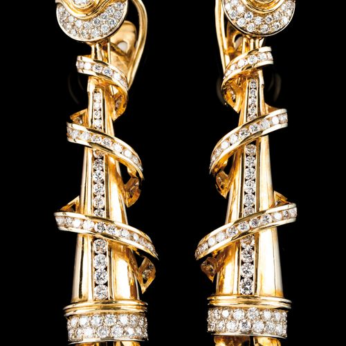 A pair of earrings Portuguese gold  Spindle shaped of twisted ribbon set with 19…