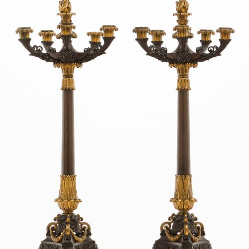 A pair of large six branch Empire style candelabra Patinated metal of gilt relie…