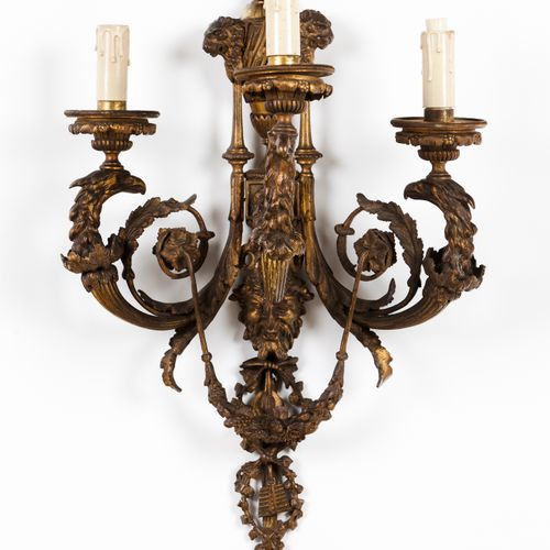 A pair of Napoleon III style three branch wall sconces Bronze  Classical masks, …