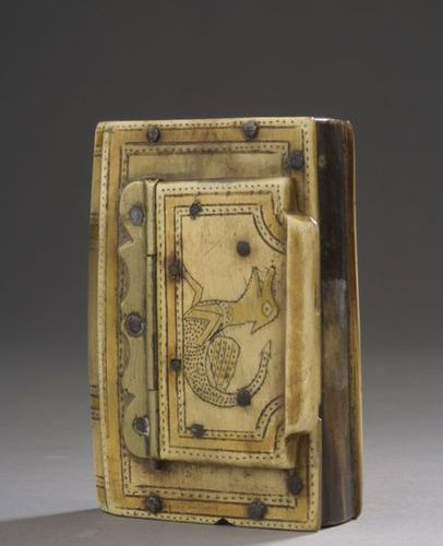 A horn snuffbox in the form of a book with a spine with an openwork spine, with …