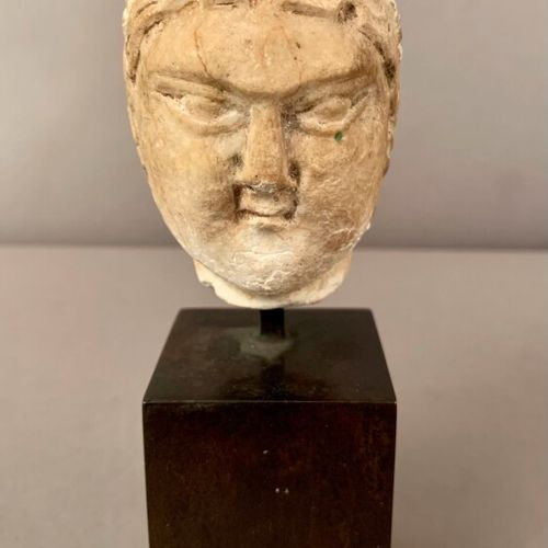 Stuccoed young lady's head.  Stone base.  Gandhara style.  H. 16 cm