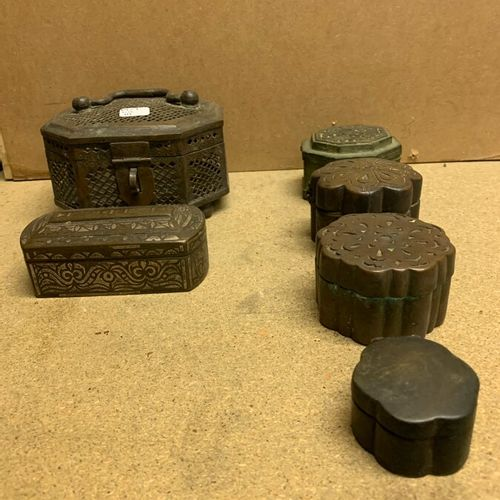 Six bronze betel boxes in octagonal, oblong or circular contoured shape. One ope…