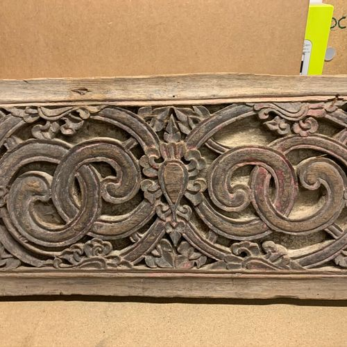 Decorative panel in carved and openwork wood with scroll motifs. Trace of polych…