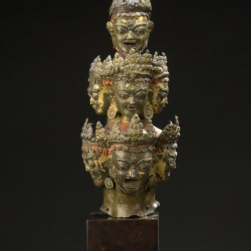 TIBET 17th/18th century  Fragment of an embossed copper copper headdress with tr…