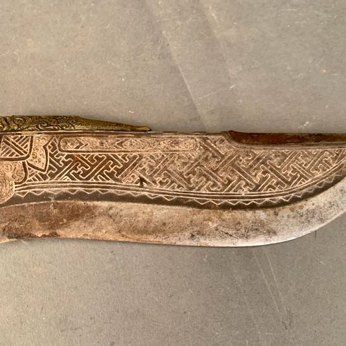 Knife, iron blade worked with geometrical patterns, wooden handle.  Tibet or Nep…