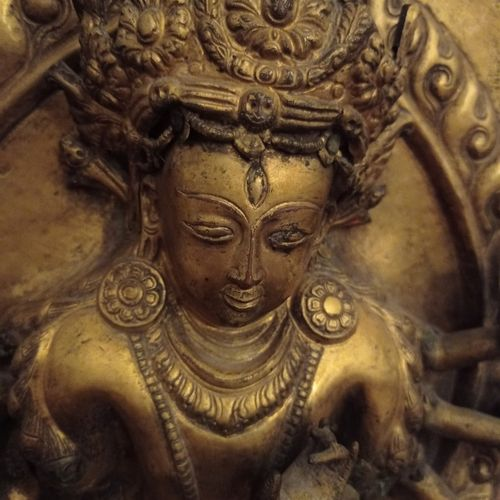 Nepal 17th/18th century  Embossed and gilded copper plate of a deity with eight …