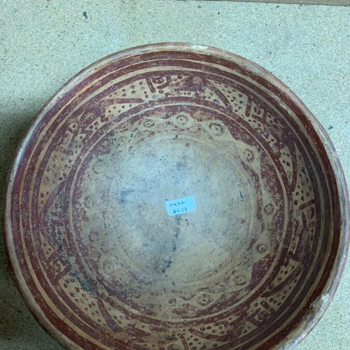Four terracotta bowls decorated with red and black slip.  Central or Latin Ameri…