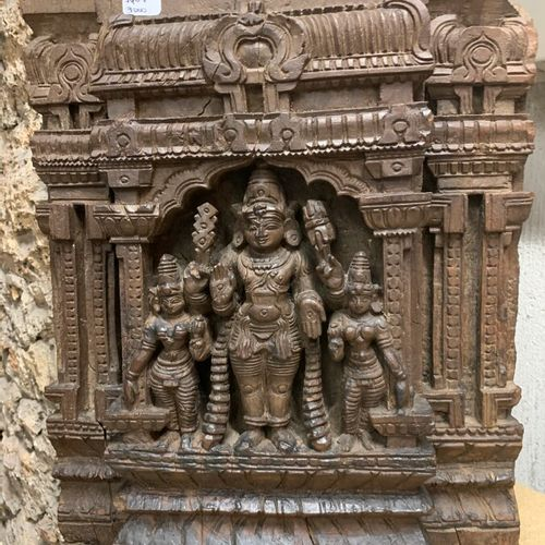Two panels (chariot wood?) in carved wood in high relief depicting Vishnu surrou…