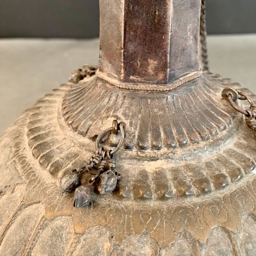 Vase with the belly in gadrooned brass decorated with bells, the collar with chi…