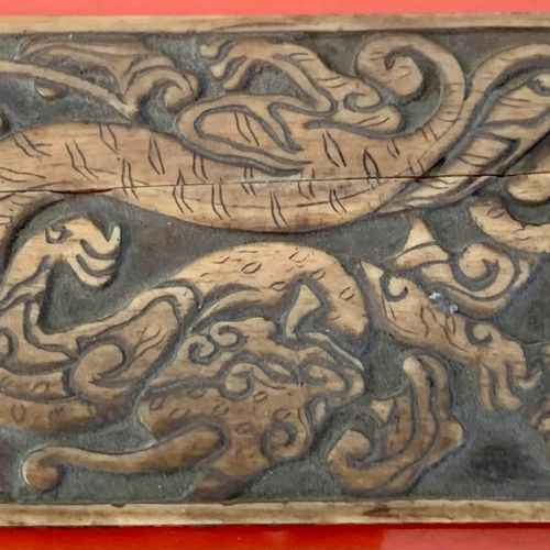 Carved bone set comprising: a plate, two ornaments and a bracelet.  Joined a car…