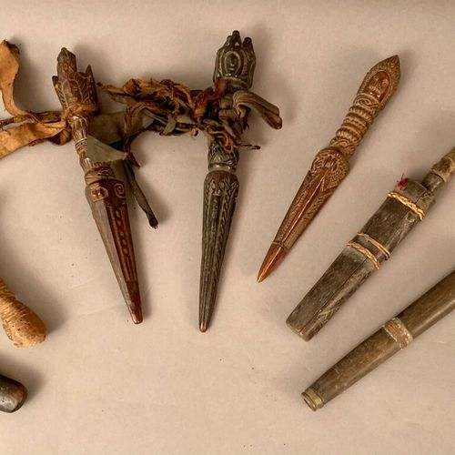 Lot including: three carved wooden shamanic Phurbu, two small daggers, iron blad…