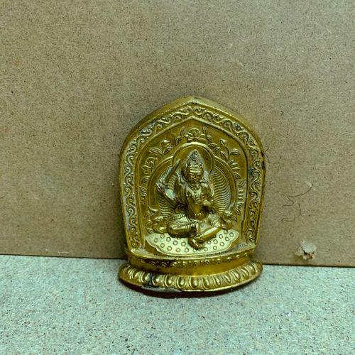 Manjusri in front of a mandorla.  Golden copper.  Tibet 19th century.  H. 8 cm h…