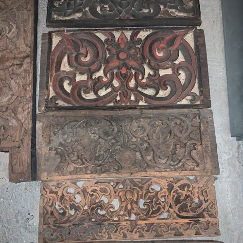 Set of nine panels and two pediments in carved and openwork wood with scrolls an…
