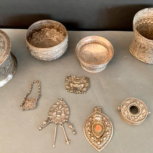 Low title silver set including: box, cups, pendants, mount, etc.  Tibet and Chin…