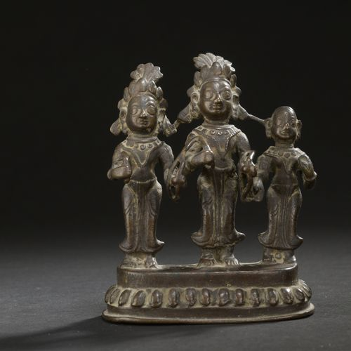 Nepal 17th/18th century  Bronze group with brown patina, three deities standing …