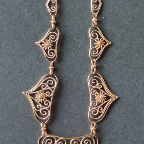 NECKLACE drapery in yellow gold 750°/°° length. 47 cm Weight : 14.7 gr